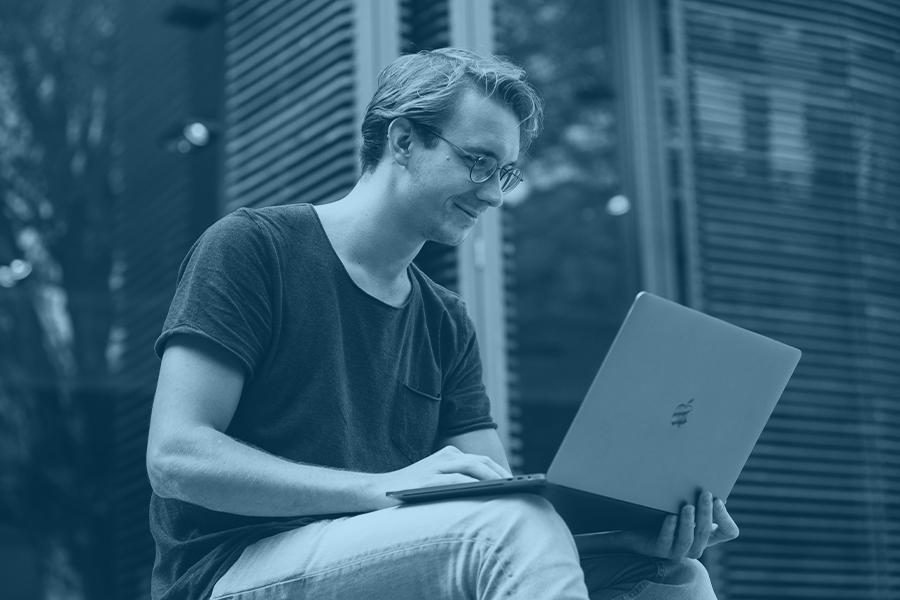 man looking at computer