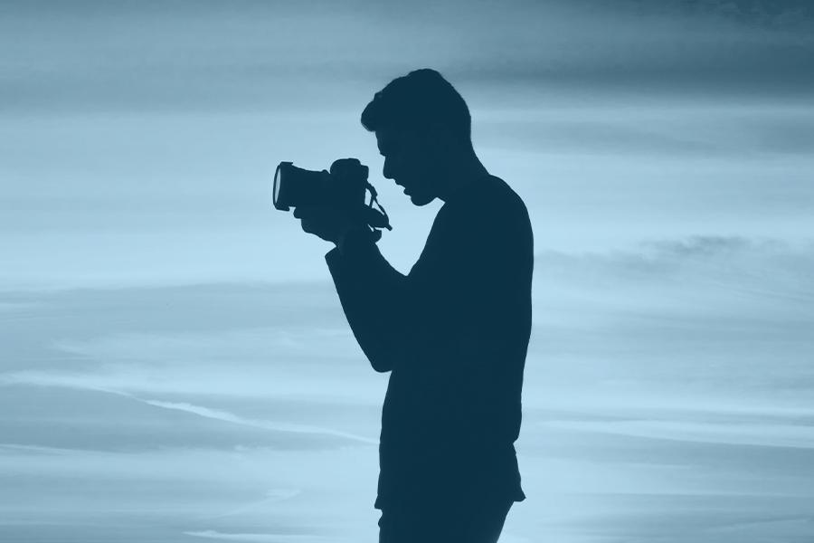 man holding cmaera